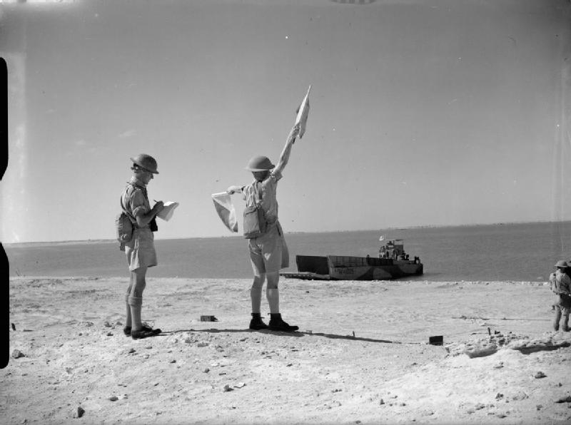 man with semaphore flags