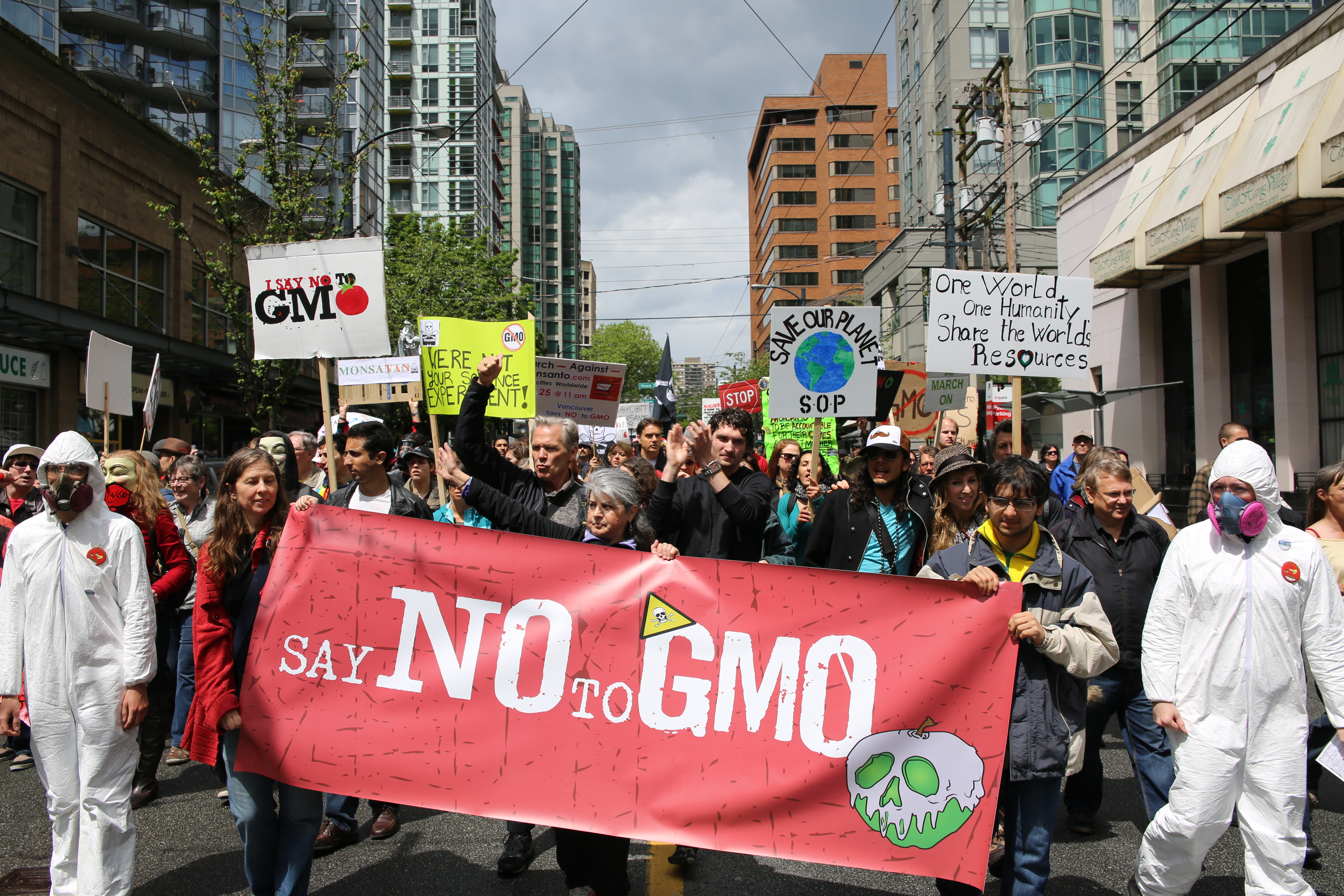 Individuals protesting the use of GMOs or Genetically Modified Organisms