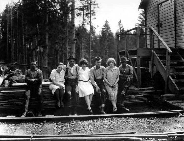 File:Men and women sitting on lumber pile, Northwest Door Company, Oregon, ca 1914 (KINSEY 2453).jpeg