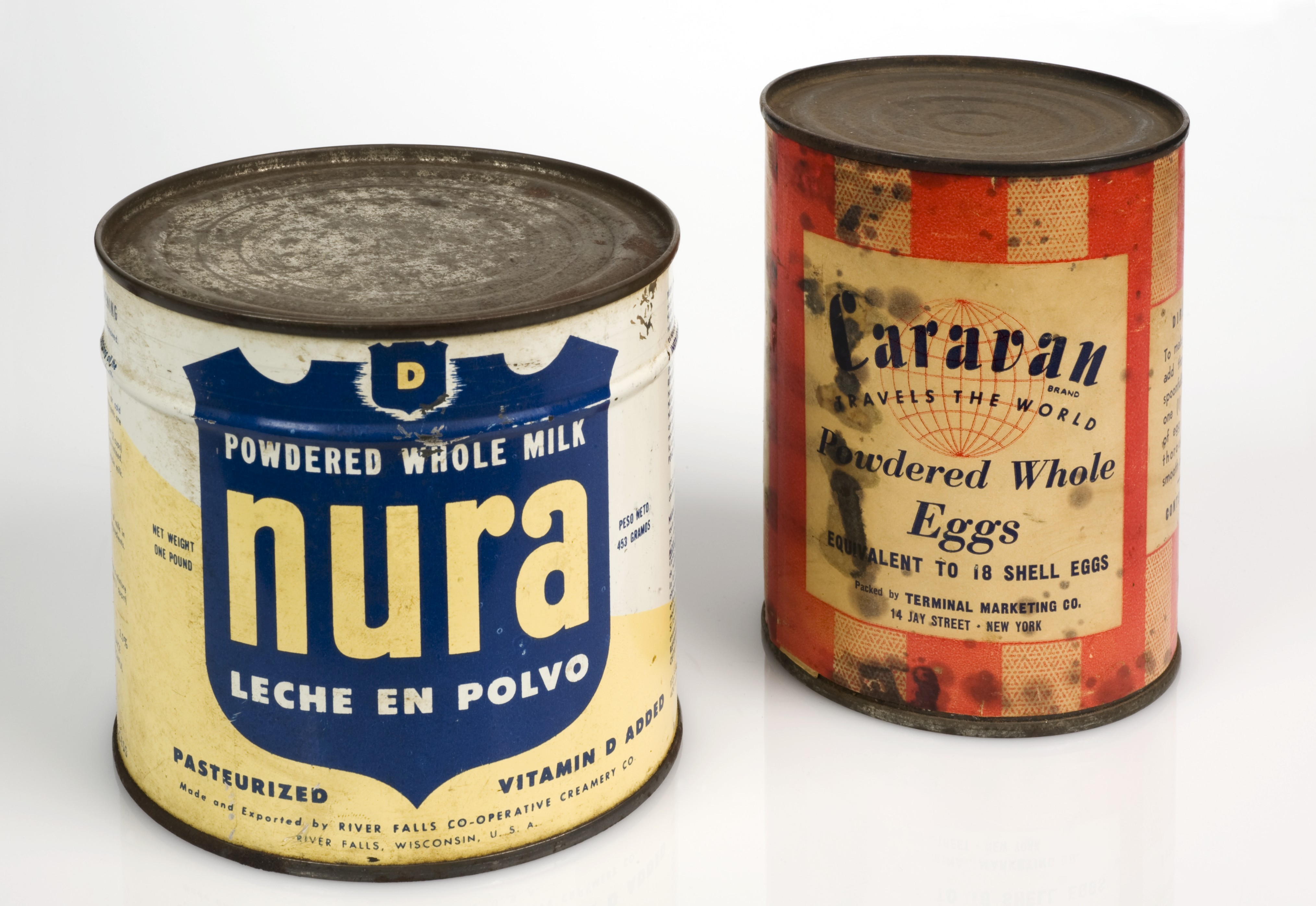 Sealed cans of powdered eggs and powdered milk supplied to