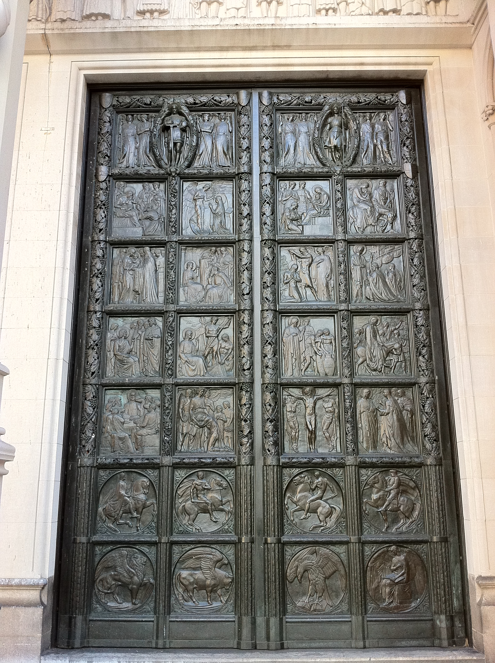 http://upload.wikimedia.org/wikipedia/commons/4/4a/Right_hand_bronze_door_at_the_Cathedral_of_St_John_the_Divine%2C_New_York.jpg