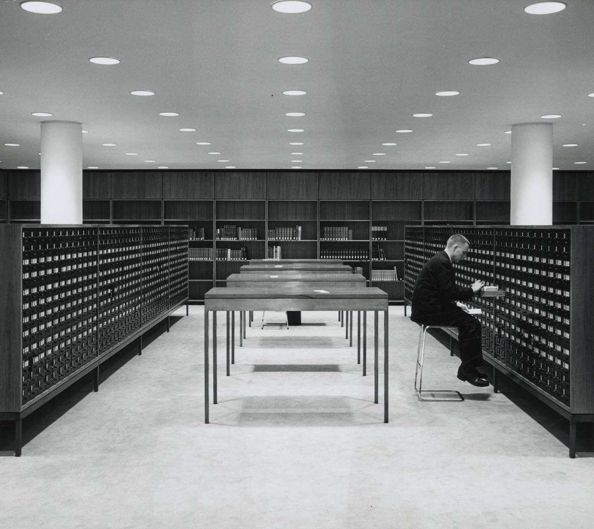 A man looks through the card catalog at the Beinecke Library