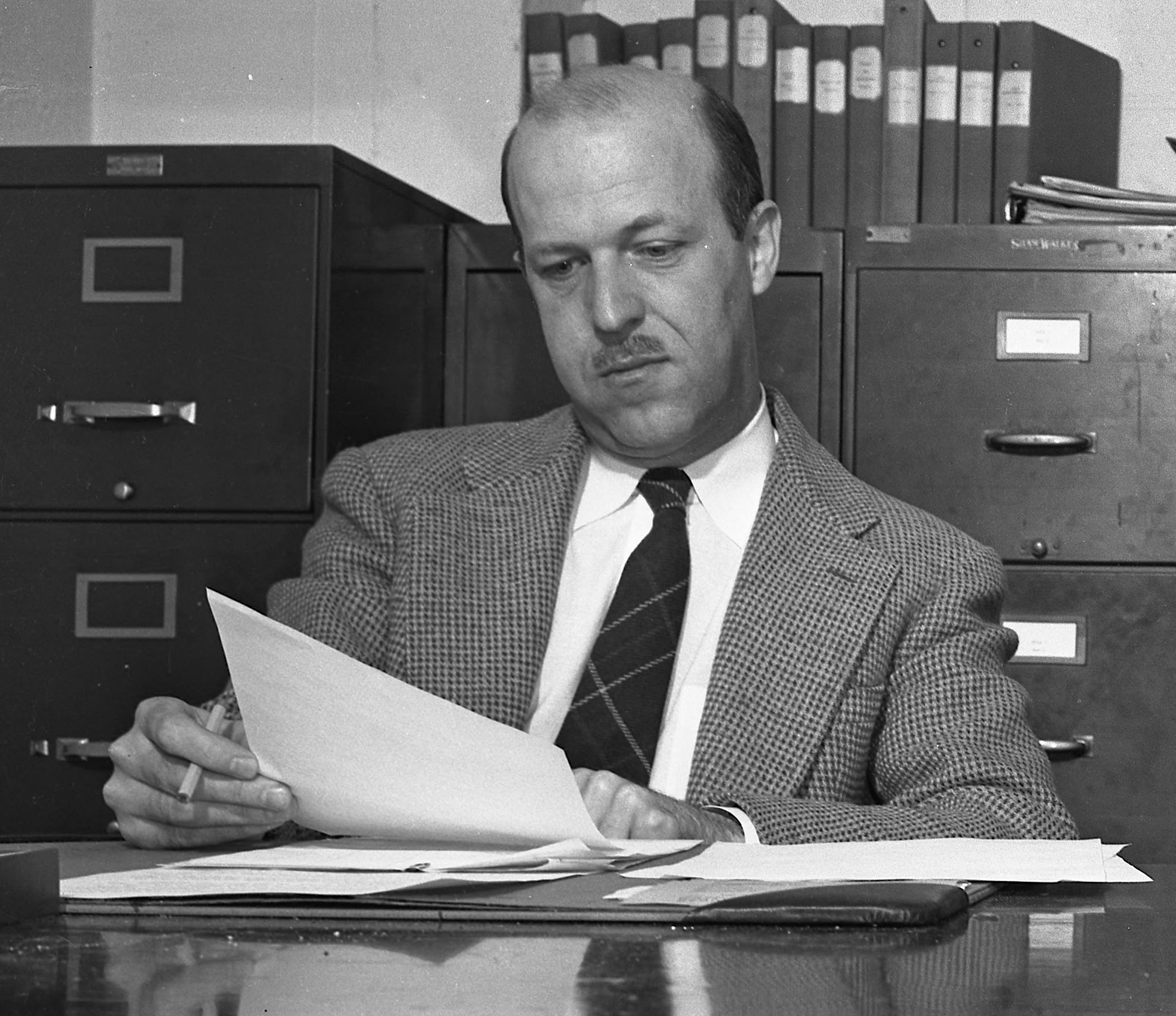 Campbell at the University of Michigan going over the plans of a survey in 1948