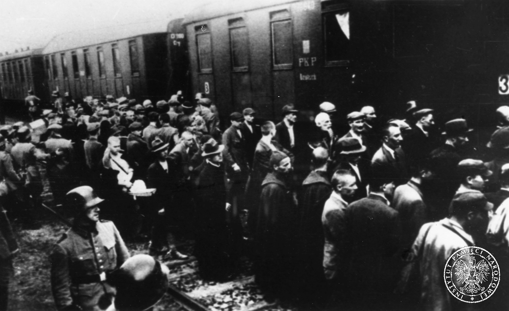 Prisoners of the first transport to Auschwitz at Tarnów railway station, 14 June 1940