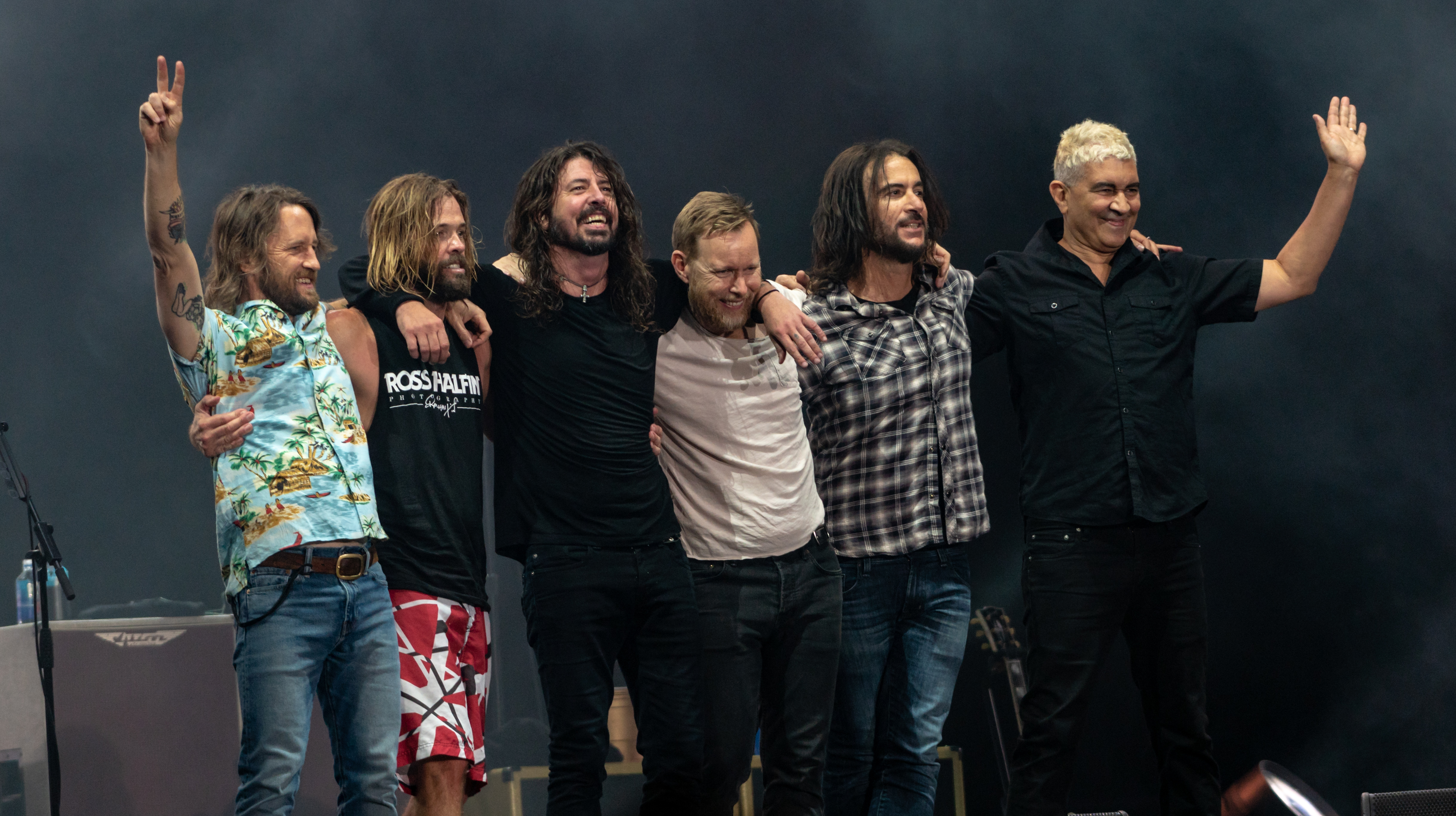 Foo Fighters after performing in June 2018. From left to right: [[Chris Shiflett]], [[Taylor Hawkins]], [[Dave Grohl]], [[Nate Mendel]], [[Rami Jaffee]], and [[Pat Smear]].