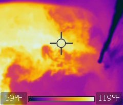 Thermal image of a sink full of hot water with cold water being added, showing how the hot and the cold water flow into each other.