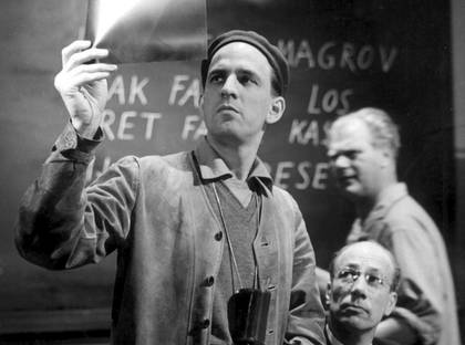 Ingmar Bergman apparently examines an x-ray film, during work on Wild Strawberries. - Film director