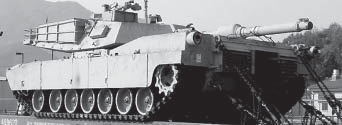 http://upload.wikimedia.org/wikipedia/commons/4/4b/M1_Abrams_tank%2C_carried_on_a_railway_flatcar.jpg