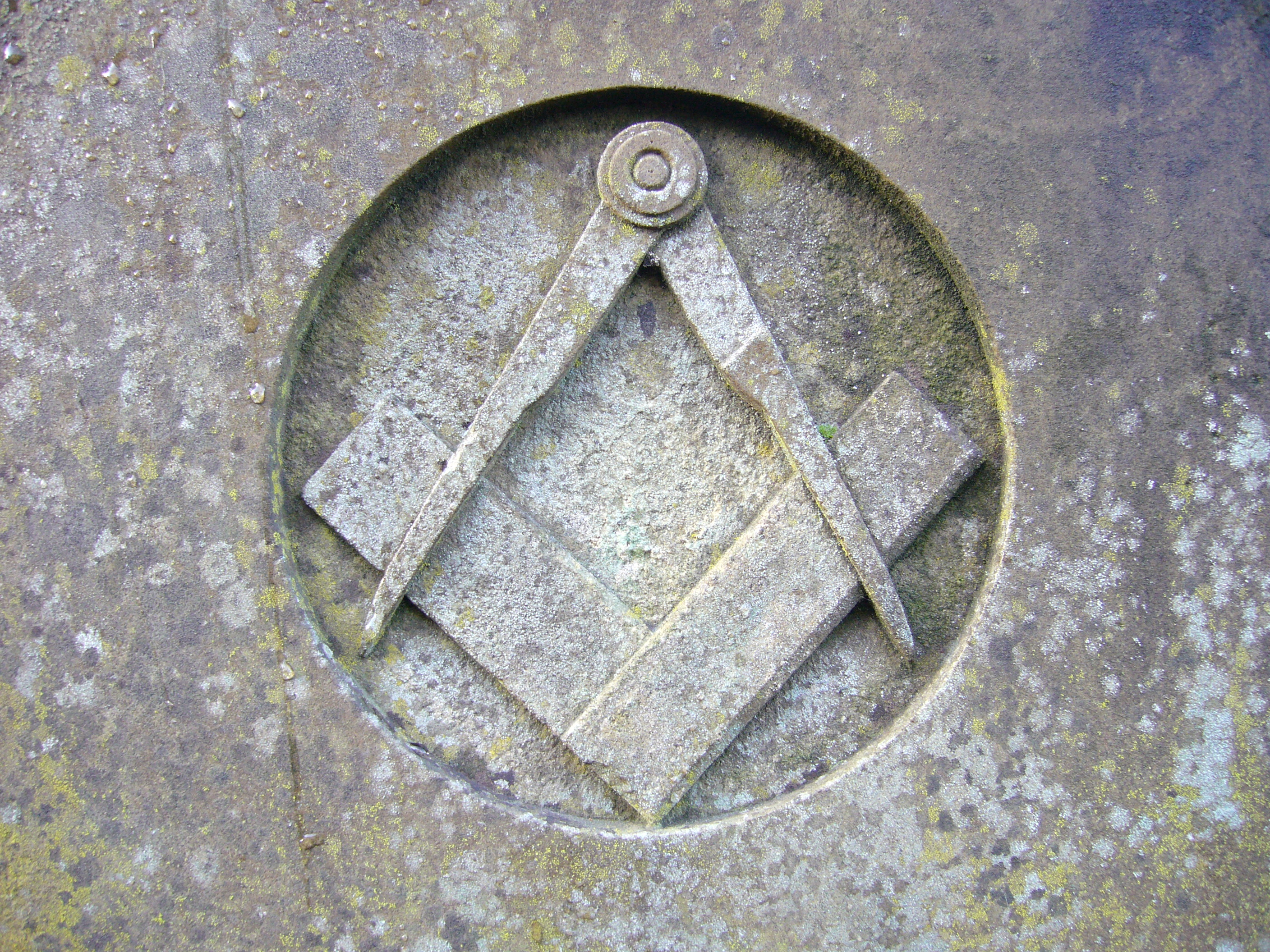 square and compass carved in stone