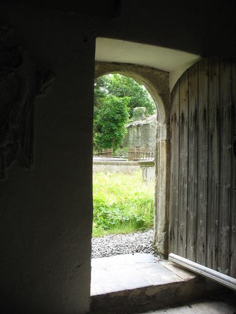File the ruined tyn llan viewed through the open door of for 0pen door