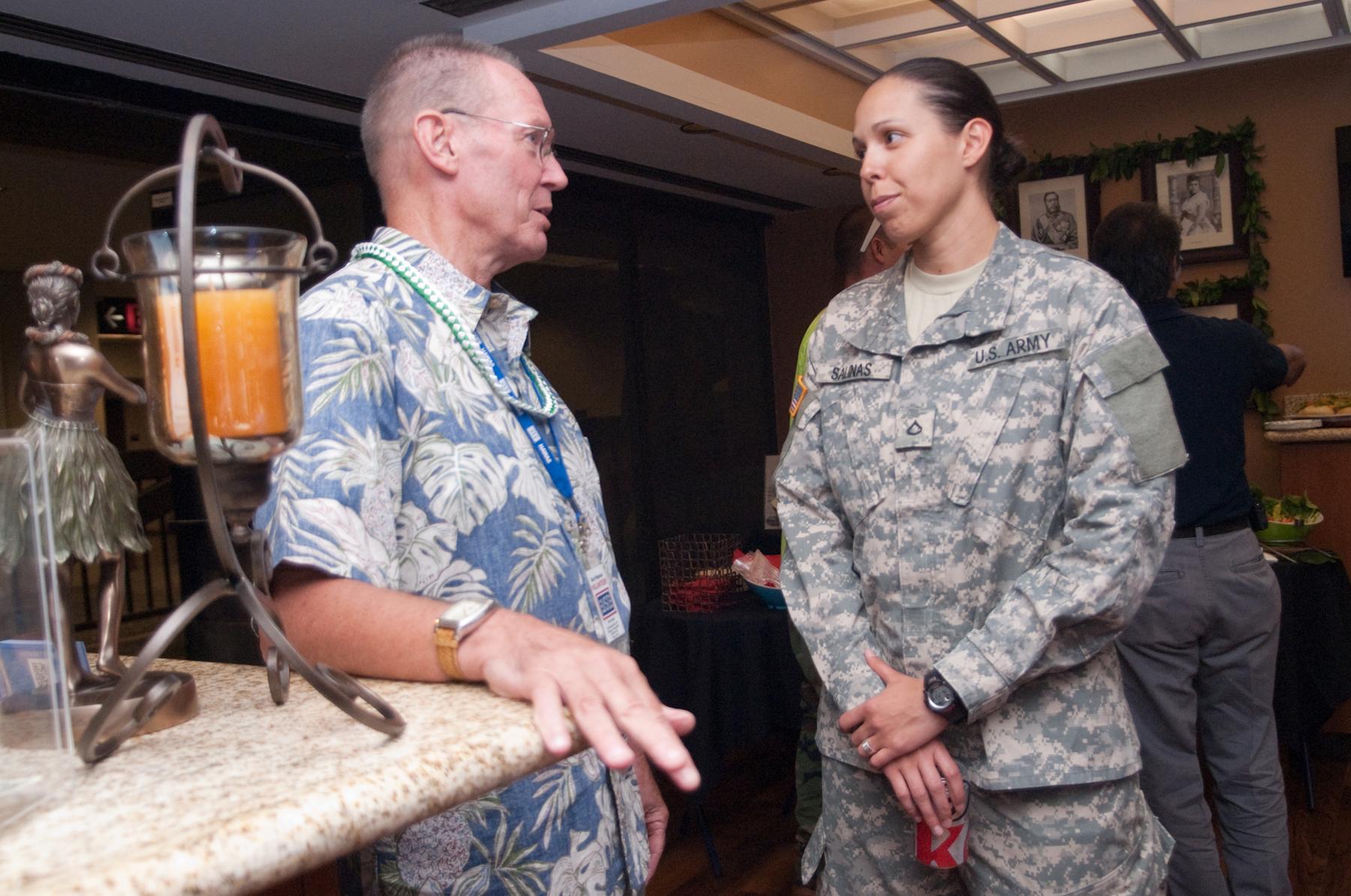 USO Hawaii celebrates airport center renovation in Honolulu 120204-M-TH981-002.jpg English: United Service Organizations volunteer Ron Peterson