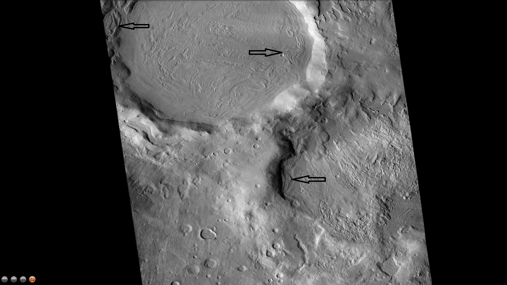 Northeast rim of Quenisset Crater, as seen by CTX camera (on Mars Reconnaissance Orbiter). Arrows indicate old glaciers.