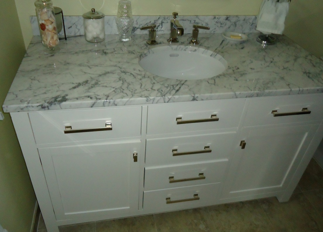 description bathroom vanity cabinet including sink and