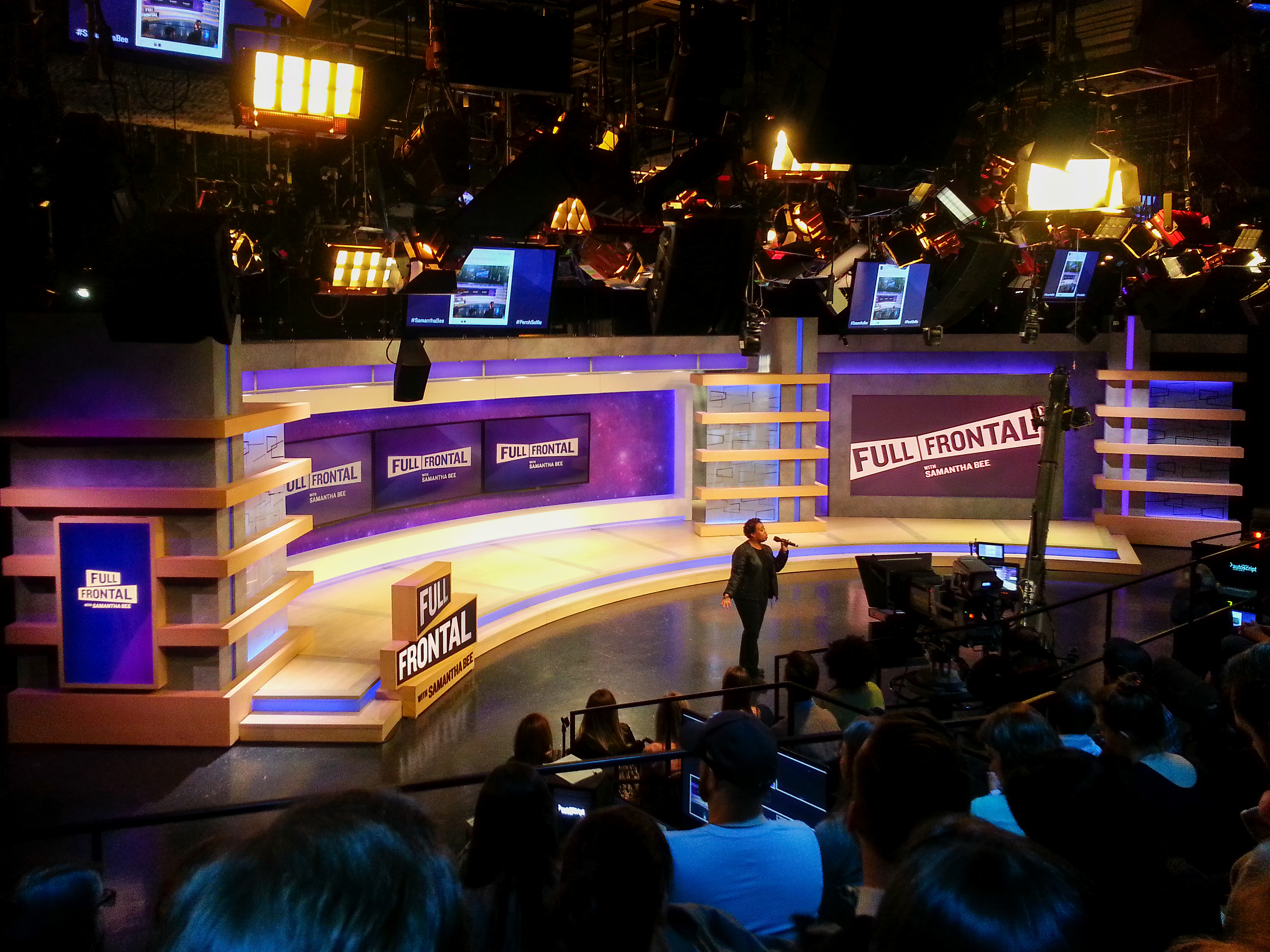 Full Frontal set - stage manager addressing audience.jpg