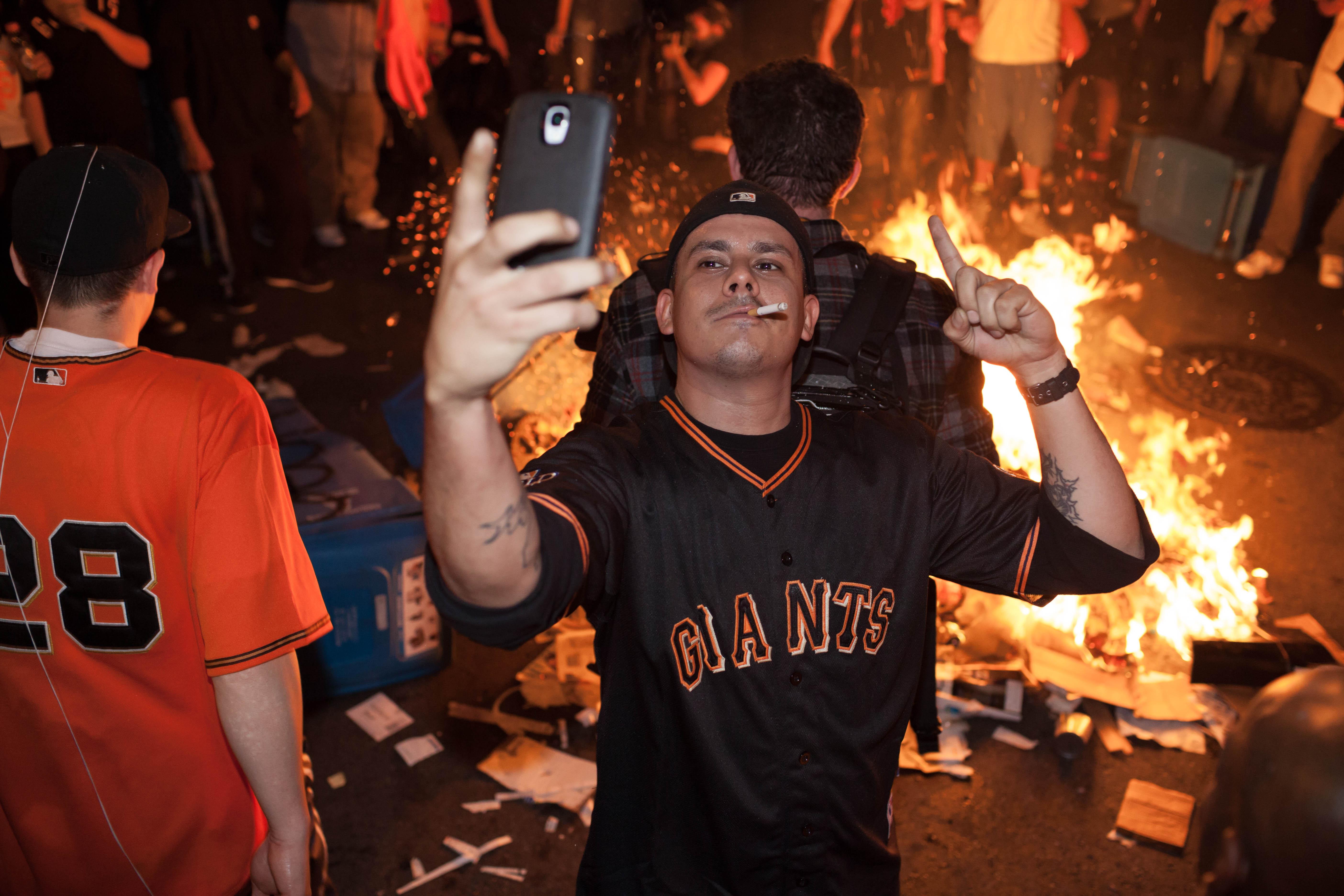 File:Man with cigarette taking selfie - San Francisco Giants