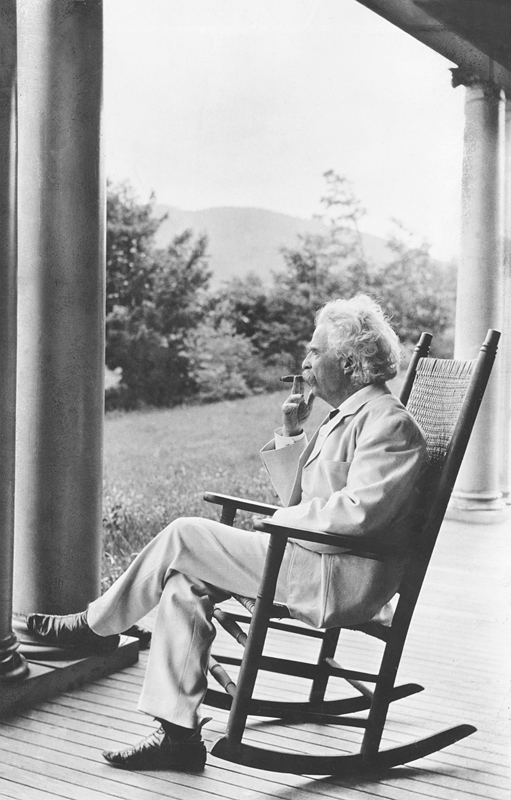 Mark Twain on a rocking chair on a porch in New Hampshire, 1905