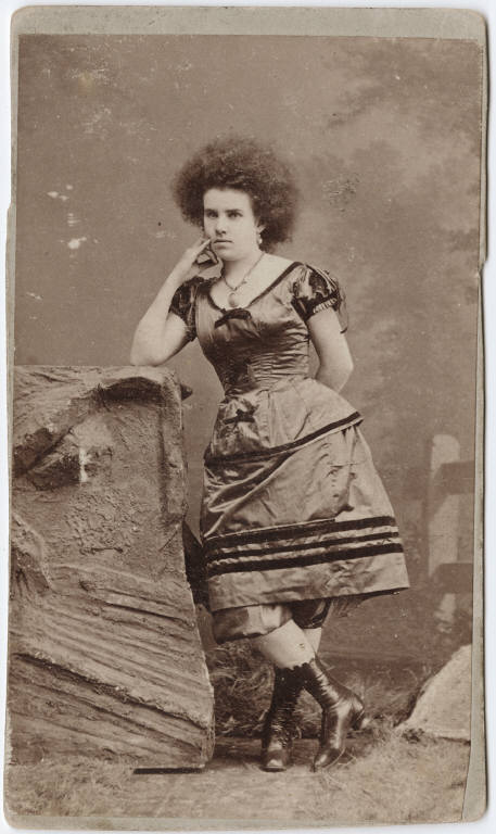 File Photograph Of A Circus Performer A Woman Leaning On