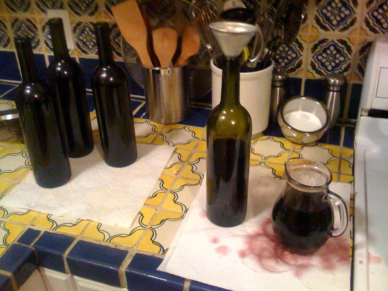 Re-bottling the mulled wine (3121184455)