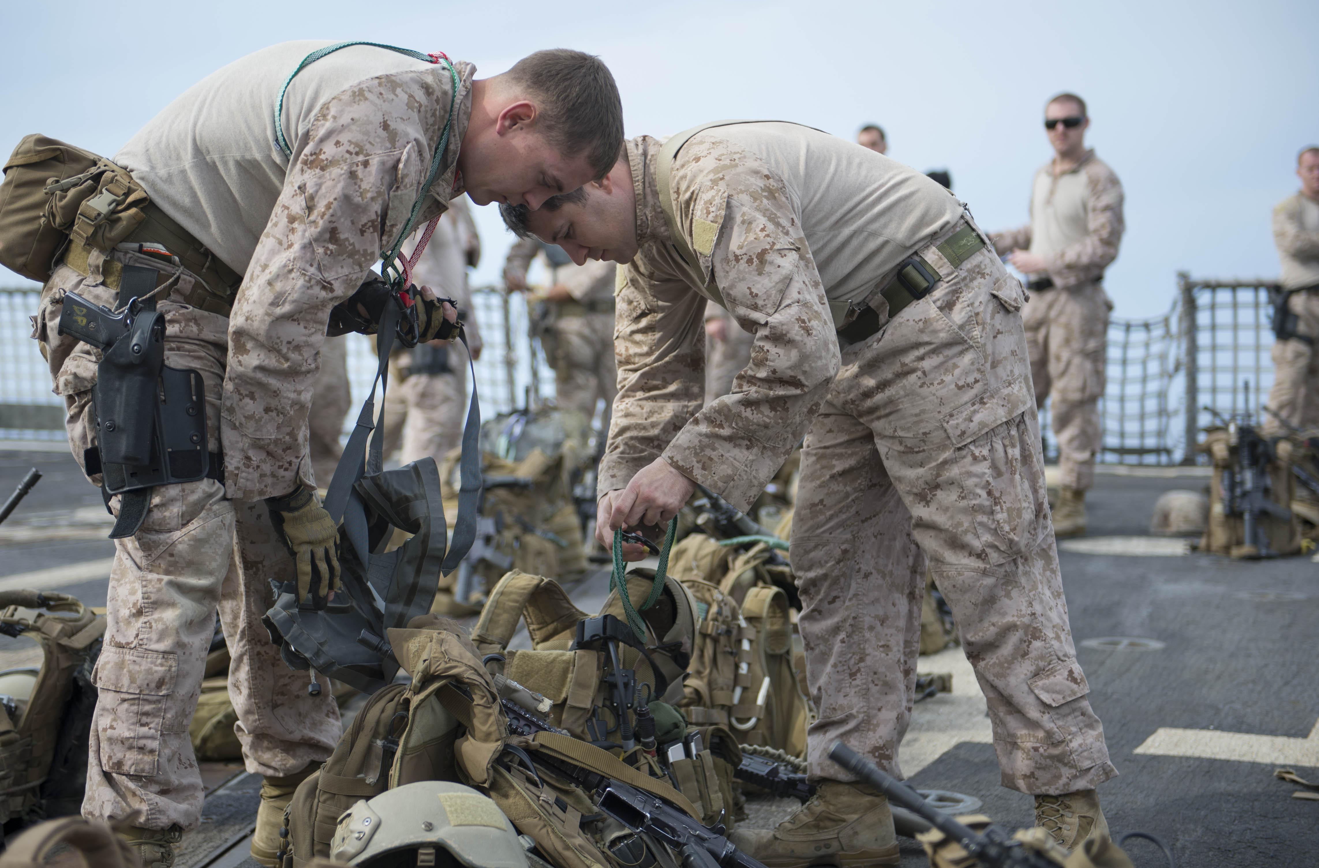 file u s  marine corps sgt  dennis price  left  and staff