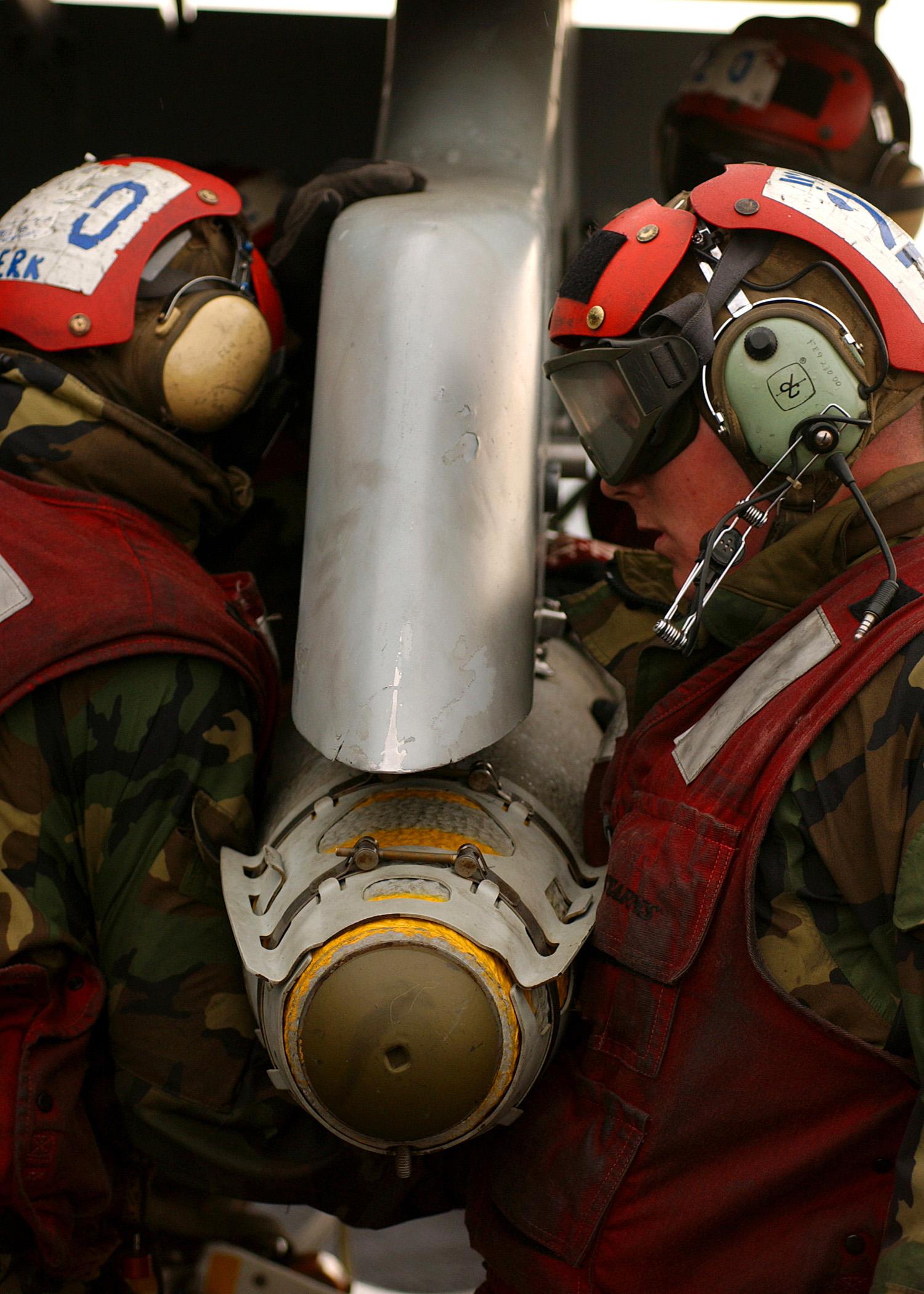 File:US Navy 050215-N-5345W-016 Aviation Ordnancemen load a