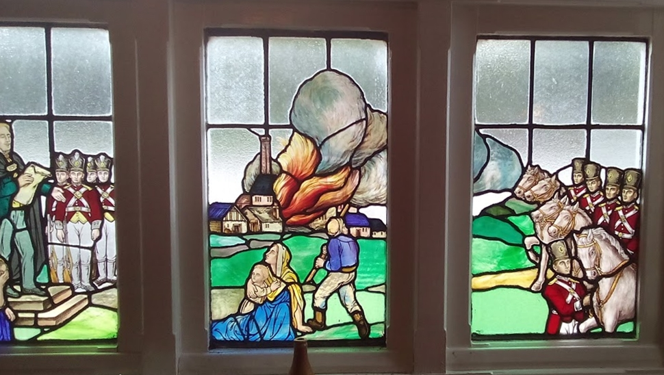 Stained glass window representing the Luddite attack on Westhoughton Mill