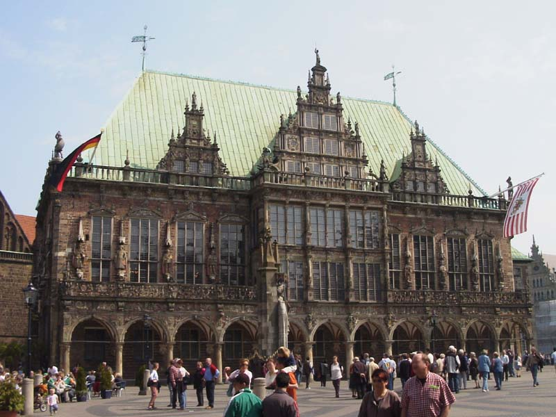 Town hall in Bremen (Germany) with the flag of the Federal Republic of Germany and the flag of the Free Hanseatic City of Bremen.