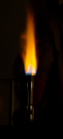 how to set a bunsen burner alight