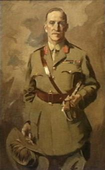 Painting of man in khaki uniform wearing a Sam Browne belt, jacket with two rows of ribbons and red tabs, and a tie. He is holding a slouch hat with emu feathers in one hand, and a swagger tucked under his left arm.