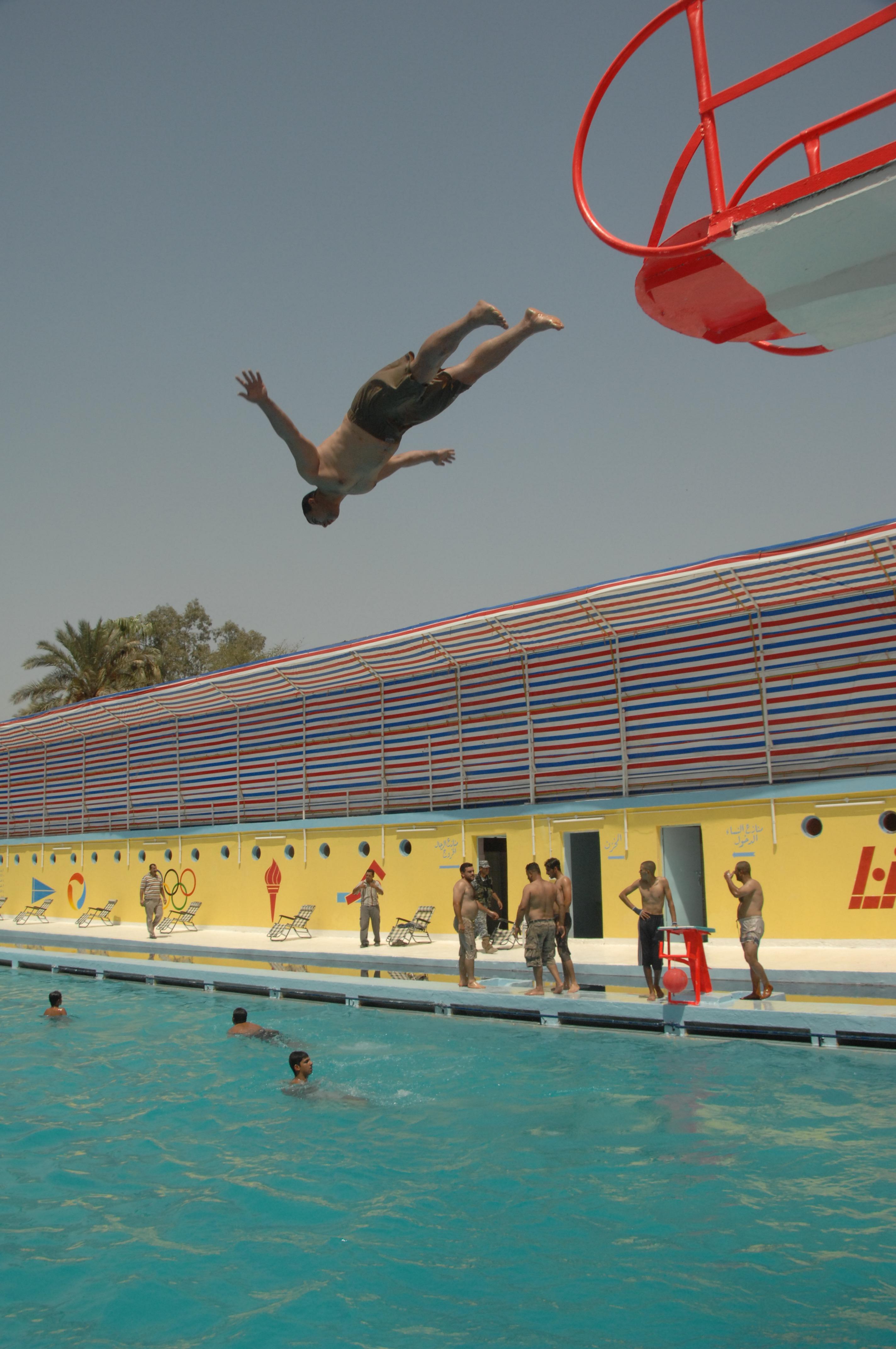 File:A man dives off the high dive platform at the al ...