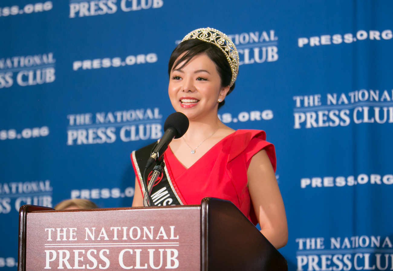 Anastasia Lin speaks at the National Press Club (Image from Wikimedia Commons).