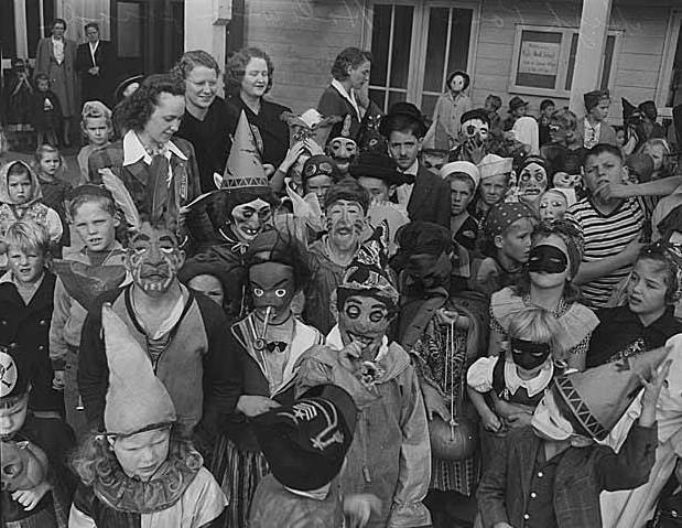 black and white photo of children in 1940s halloween costumes