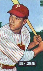 "A baseball-card image of a man wearing a white baseball uniform pinstriped with red and a red baseball cap with a white ""P"" on the face"