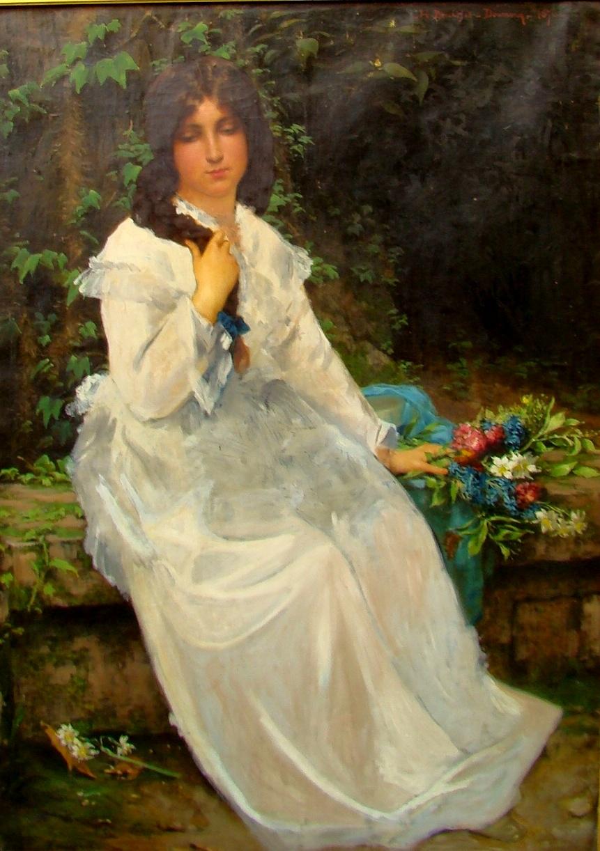 FileJeune femme réveuse en robe blanche assise dans un