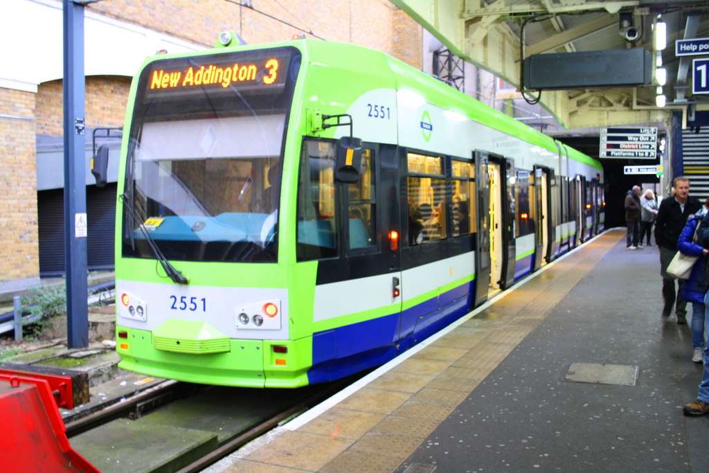 "A green and blue tram, with the number 2551, and a destination of ""New Addington 3"""