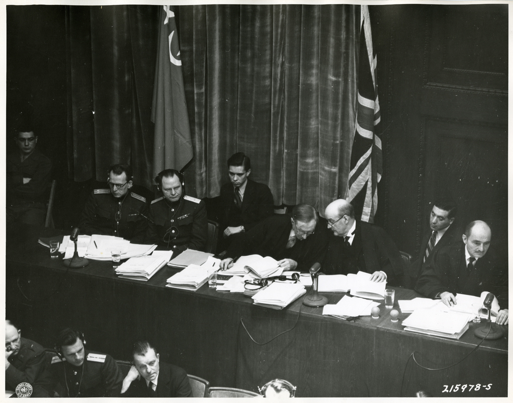 https://upload.wikimedia.org/wikipedia/commons/4/4f/Panel_of_justices_and_attorneys_Nuremberg_Trials_1945.jpeg