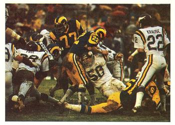 The Vikings' famed Purple People Eaters defensive line stopping a Rams rush in the 1977 NFC Divisional Playoff game. 1986 Jeno's Pizza - 18 - Alan Page.jpg