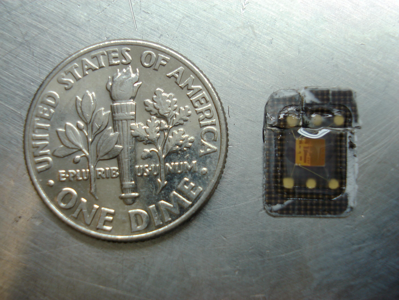 hememorychipfromamicro-cardwithouttheplasticbackingplate,nexttoaimenitedtatescoindime,whichisapprox.18mmindiameter