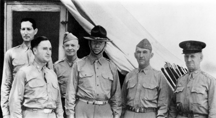 Group portrait of six men in Army uniforms. Lear is conspicuously wearing a campaign hat. Krueger and Eisenhower wear garrison caps.