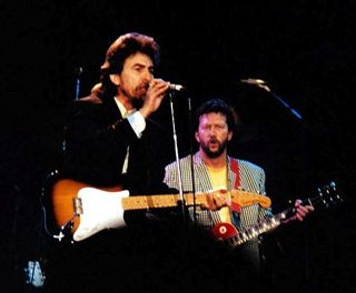 "Harrison and Eric Clapton performing ""While My Guitar Gently Weeps"" at the 1987 Prince's Trust Concert in London Harrison and Clapton 1987 cropped.jpg"