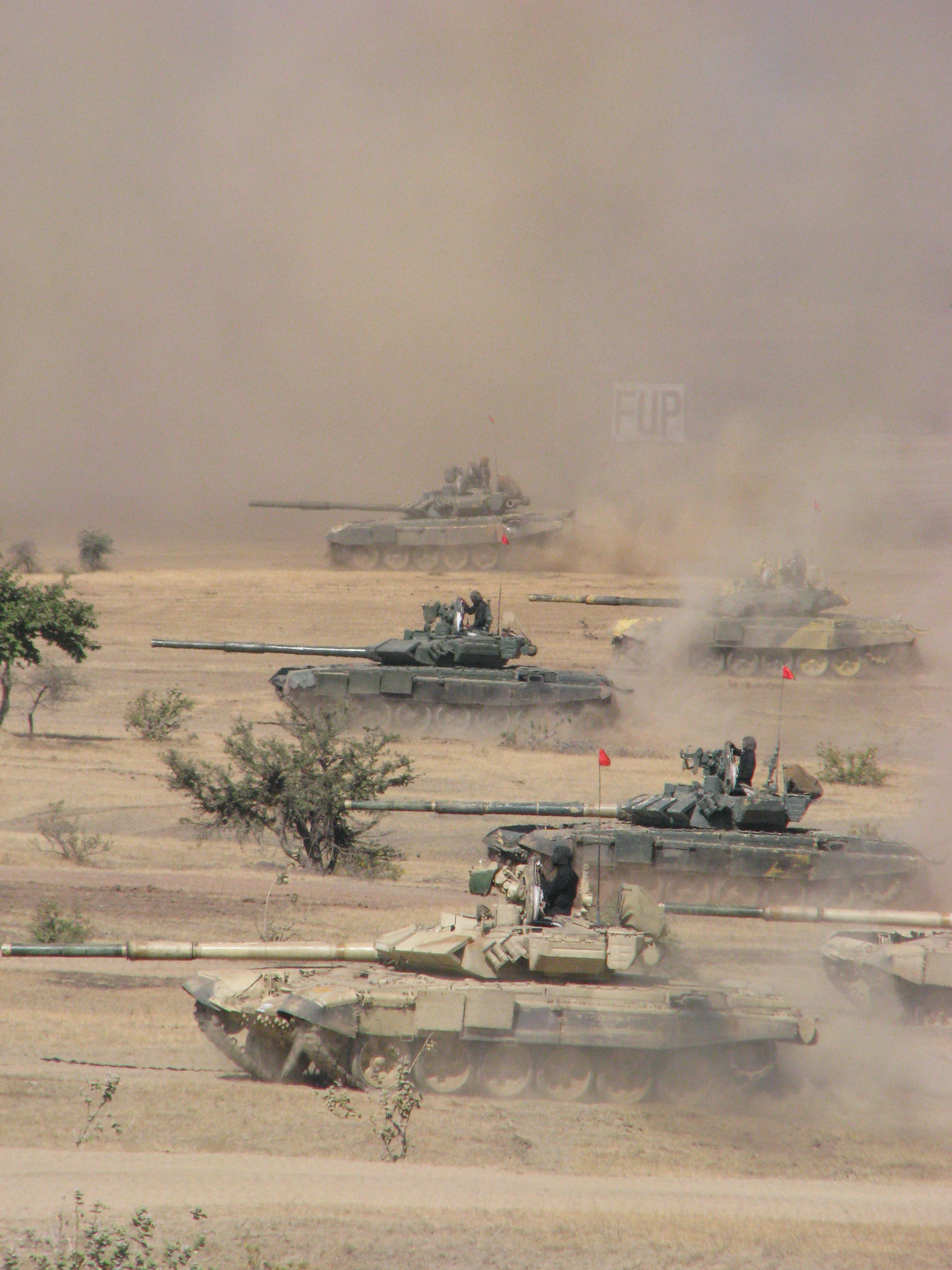 Indian Army s T 90 Bhishma tanks take part in a military training