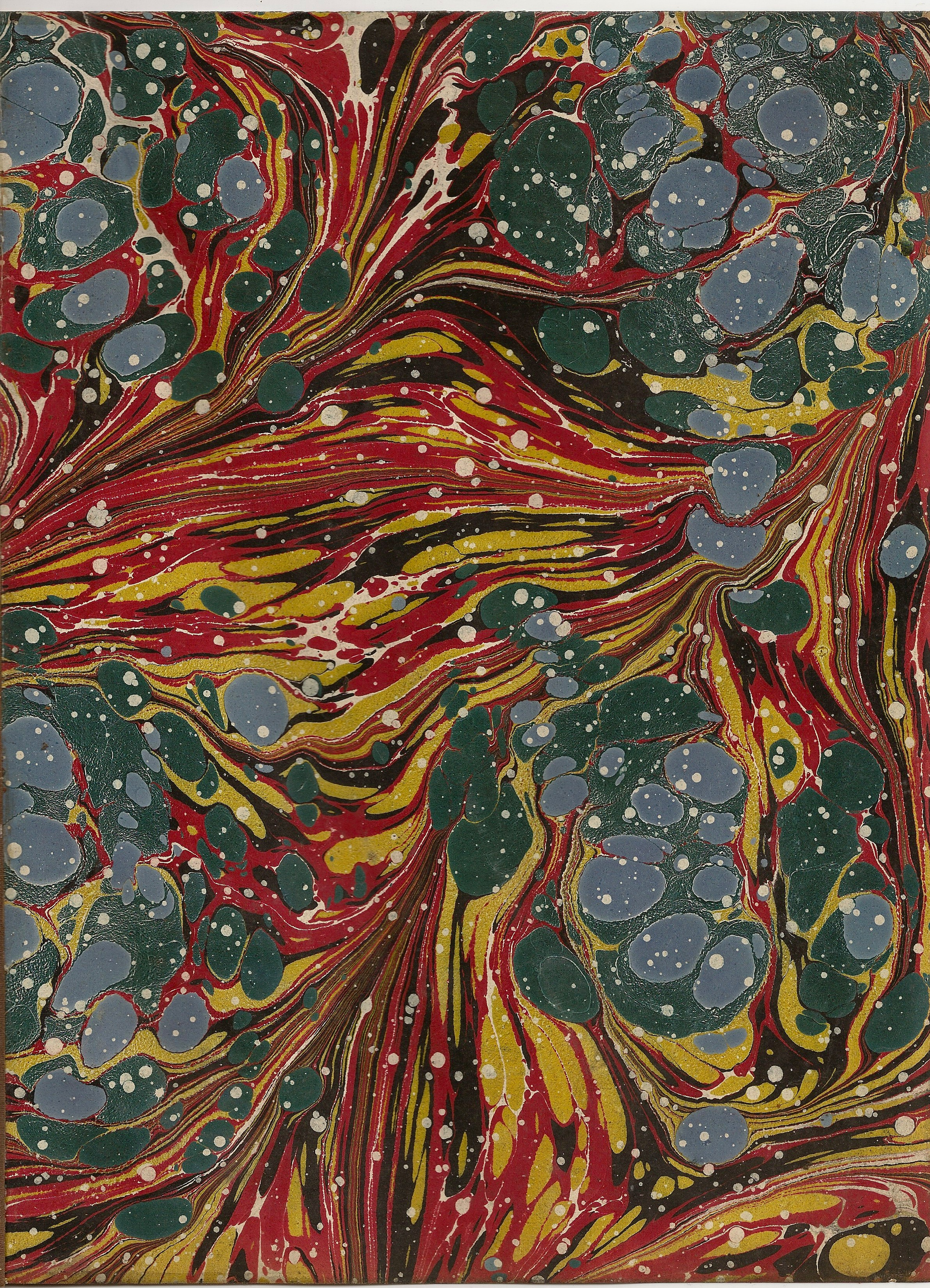 splashes of color marbled in paper such as that used in fine press books.