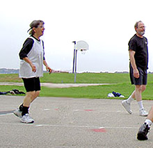 S.J. Rozan and Kent Krueger playing basketball at the 2006 Bouchercon in Madison, Wisconsin.jpg