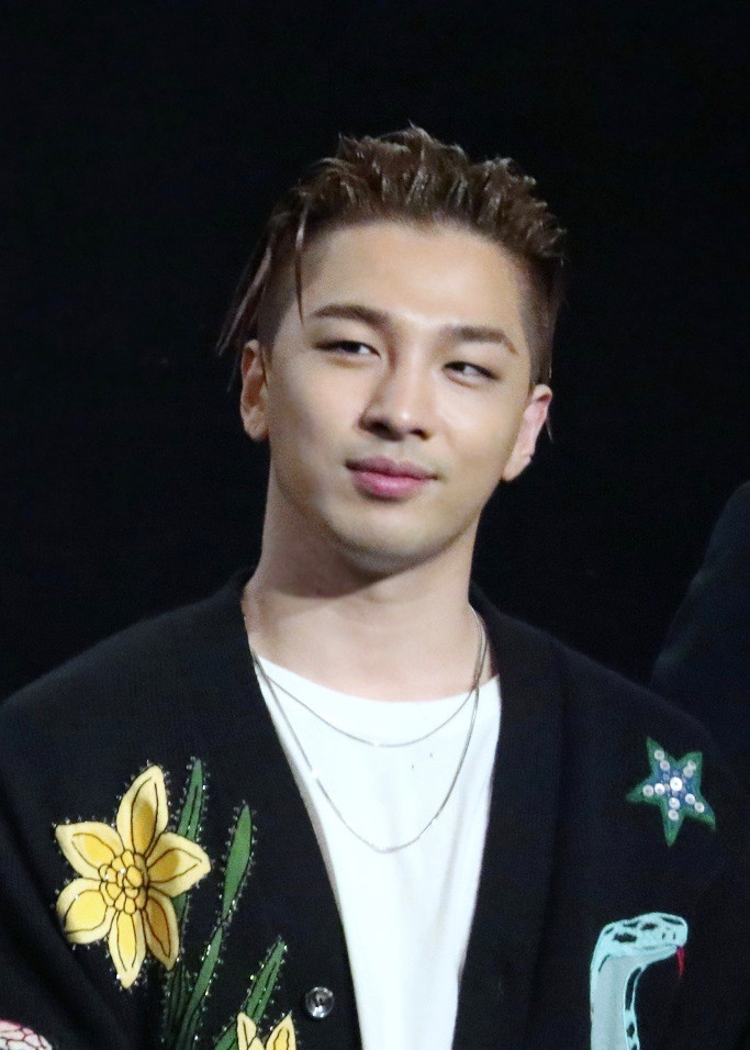 The 30-year old son of father (?) and mother(?) Taeyang in 2018 photo. Taeyang earned a  million dollar salary - leaving the net worth at 10 million in 2018
