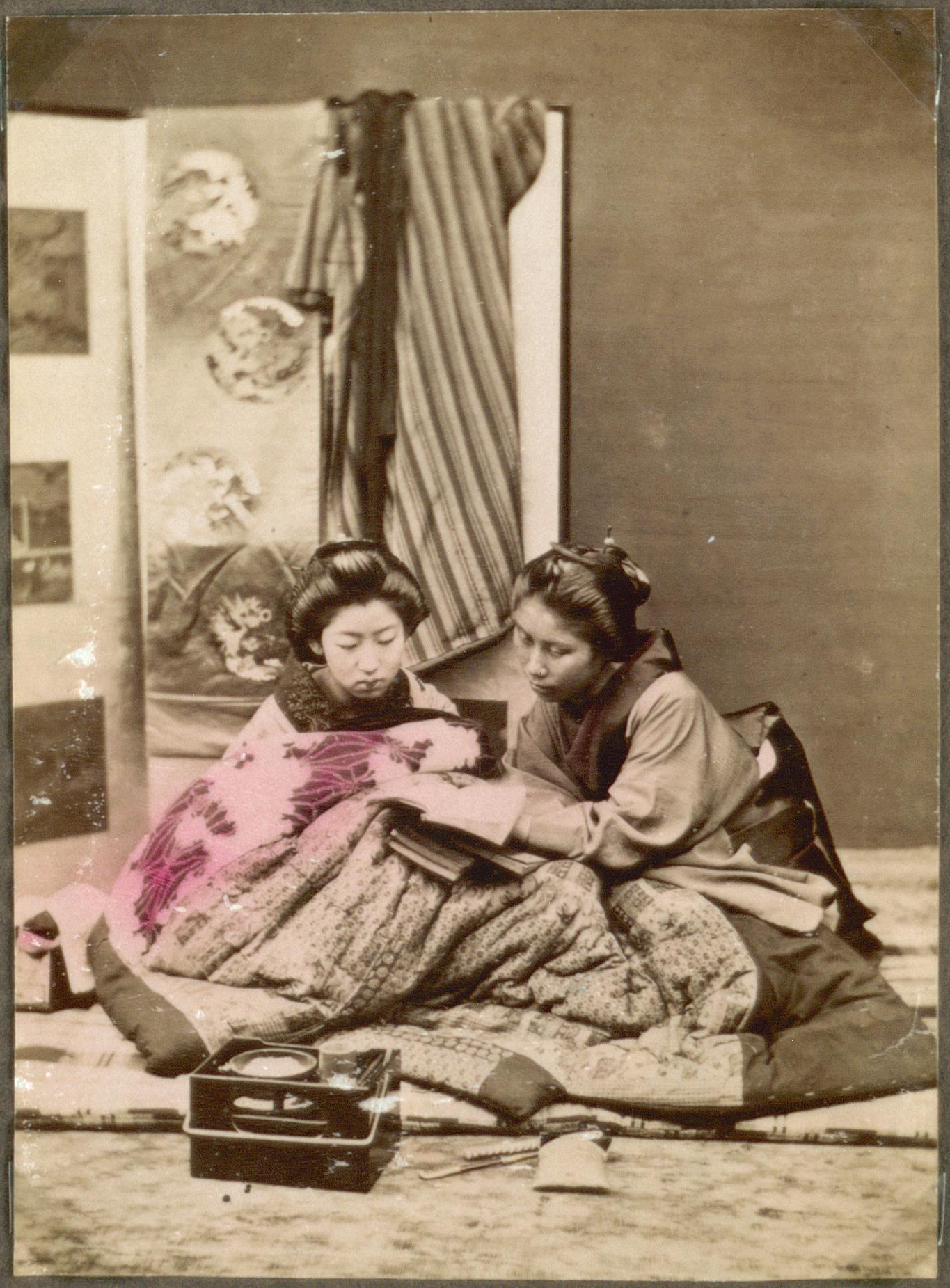 file two women reading japan 10797492886 jpg wikimedia commons