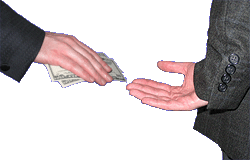 One hand giving money to another hand, held behind a back.