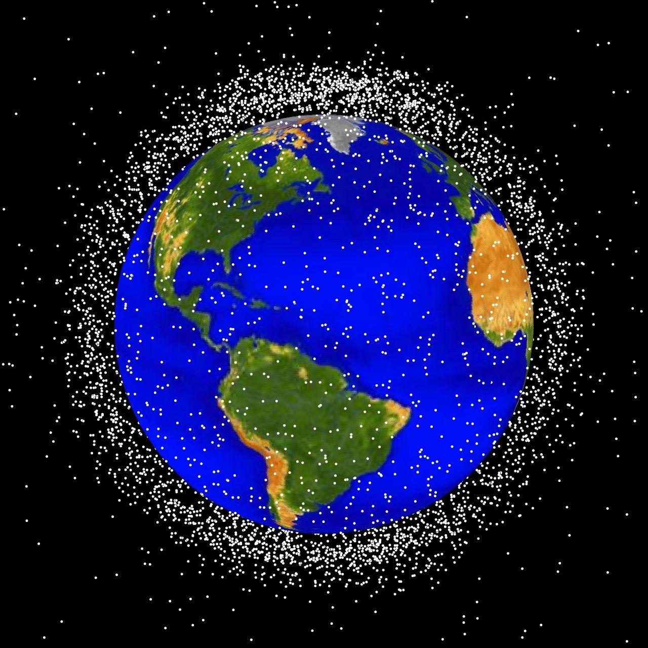 Ilustração dos detritos espaciais em torno na Terra. Imagem fora de escala.