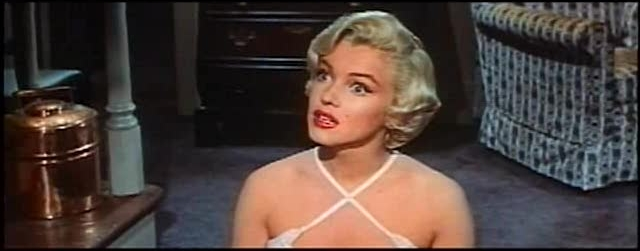 File:Monroe listening in The Seven Year Itch trailer 1.jpg