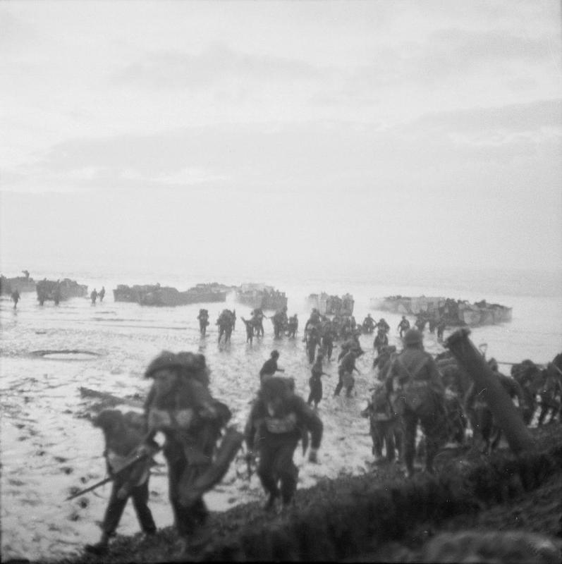 Men of the 4th Special Service Brigade wade ashore from landing craft near Flushing to complete the occupation of Walcheren