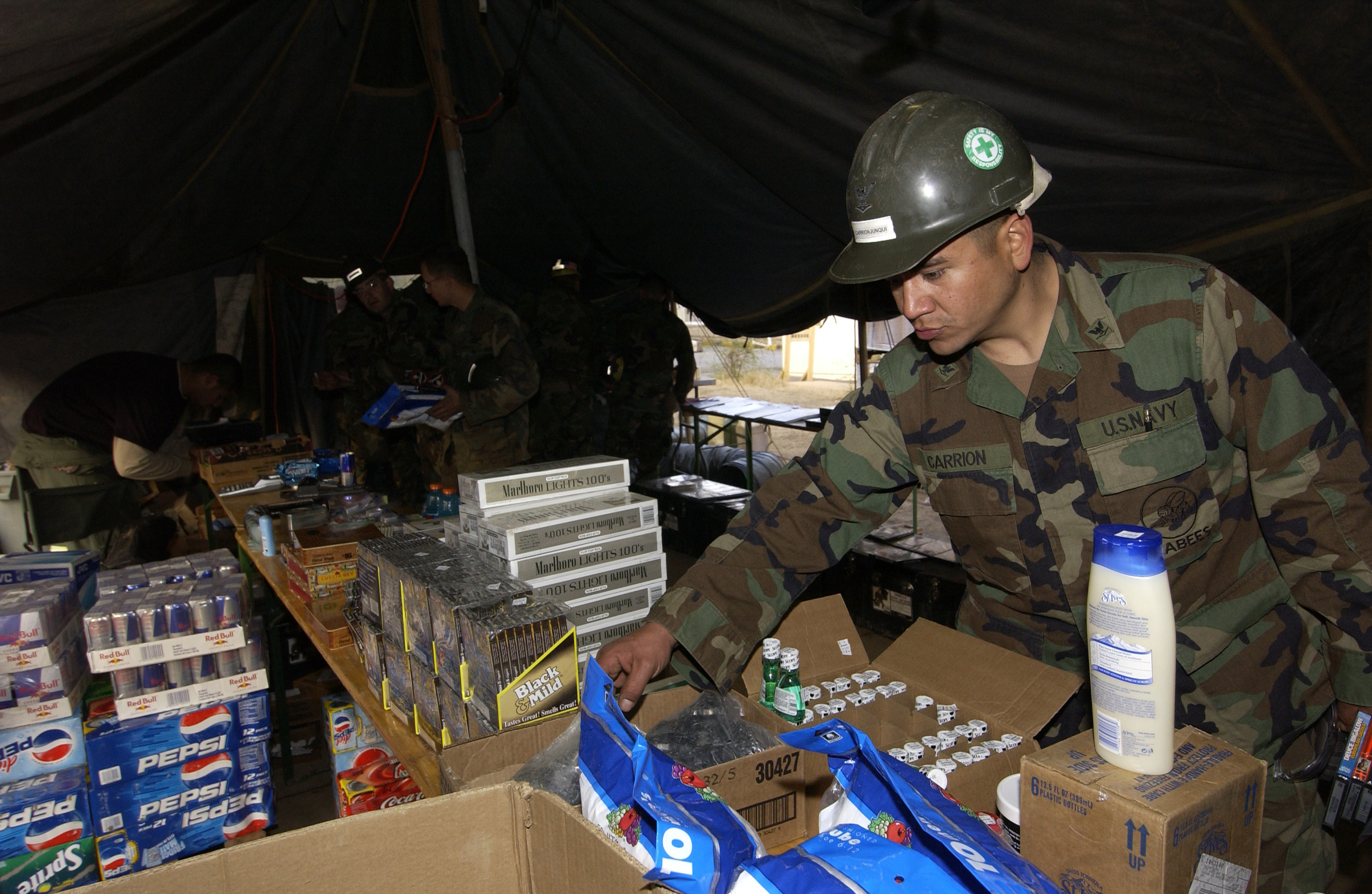 c7fb4ed94542e ... Carrion-Junqui assigned to Naval Mobile Construction Battalion Four  (NMCB-4), shops at a forward deployed Army and Air Force Exchange Service  store in ...