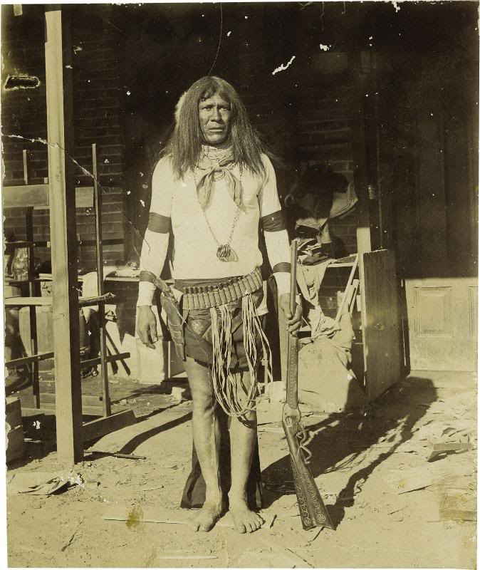Apache with Evans rifle.jpg
